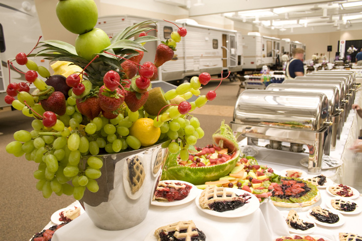 Blue Gate Catering table of Pies with a fruit arrangement beautifully displayed
