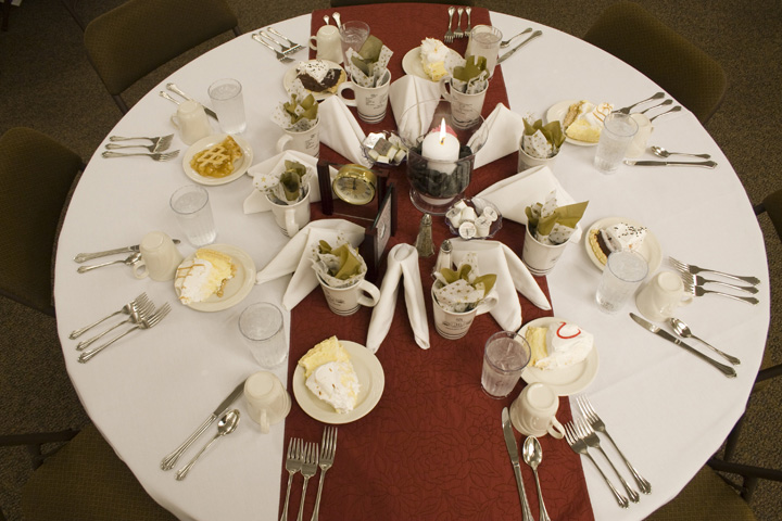 A dining table set for a conference dinner by Blue Gate Catering