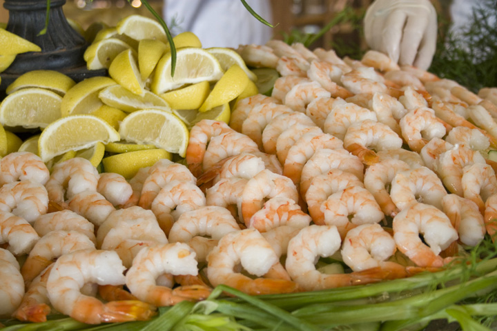 A shrimp platter on a buffet.