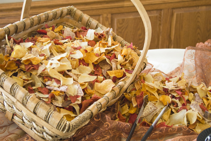 A basket full of tortilla chips on a Blue Gate Catering buffet.