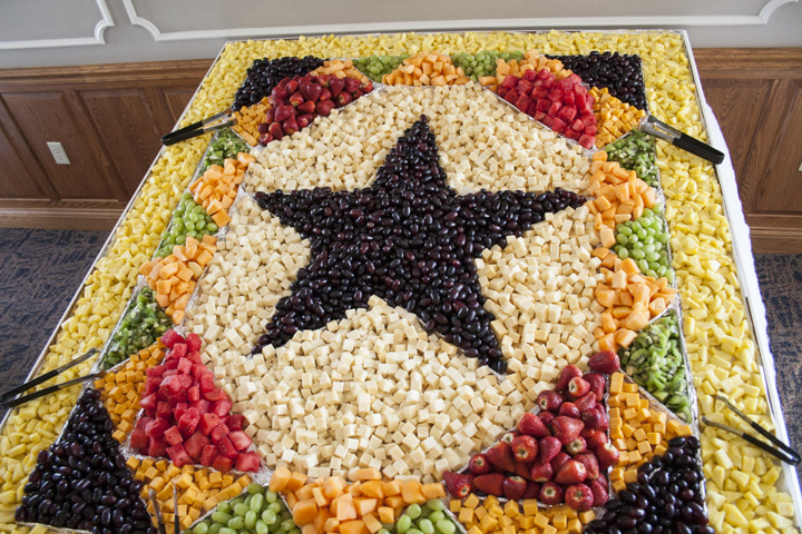A large fruit and cheese diplay in the shape of a quilt for a Blue Gate Theatre event