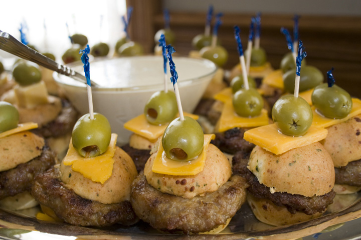 pork sliders on a tray with a horseradish sauce for a special event.