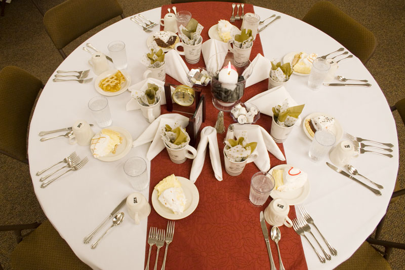 A table set for a meal at a conference or convention