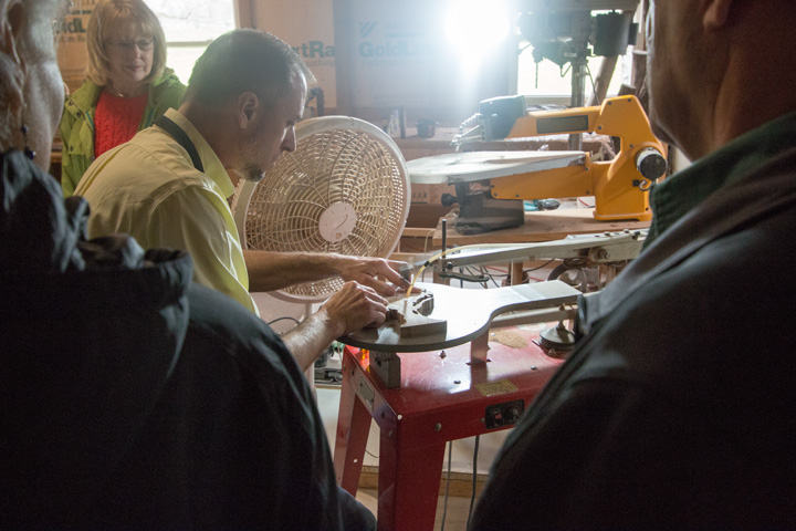 A local woodworker demonstrates on an Amish Country Tour