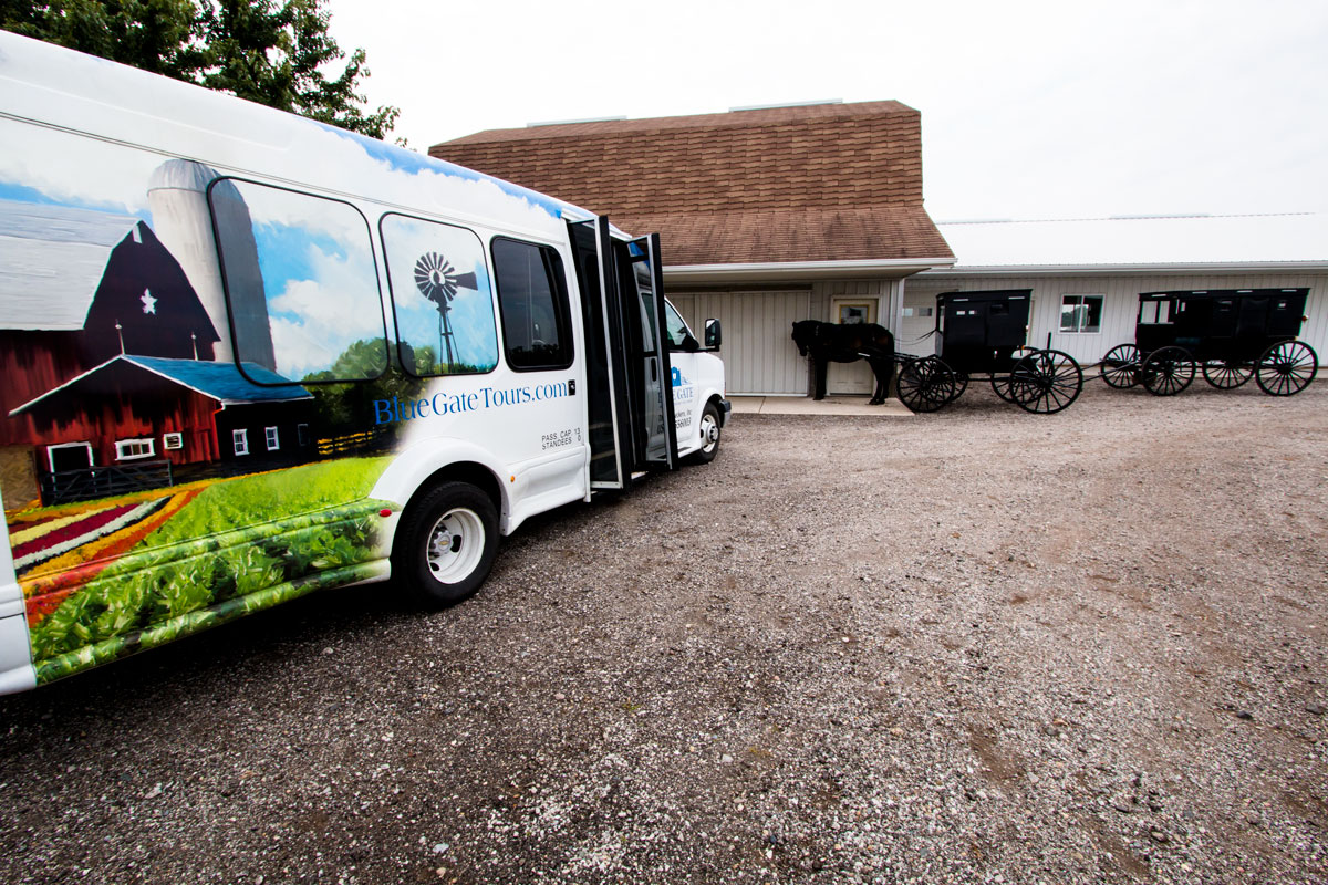 The Blue Gate Amish Tours Bus at an Amish Home
