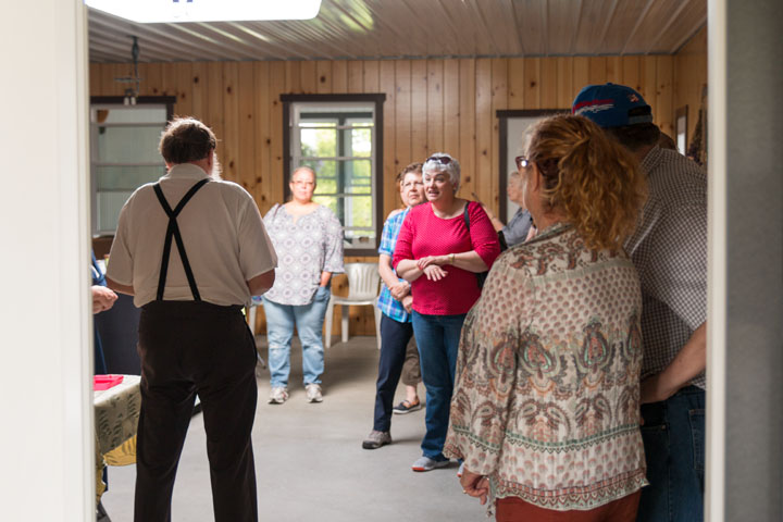 A local Amishman answers questions from a tour group.
